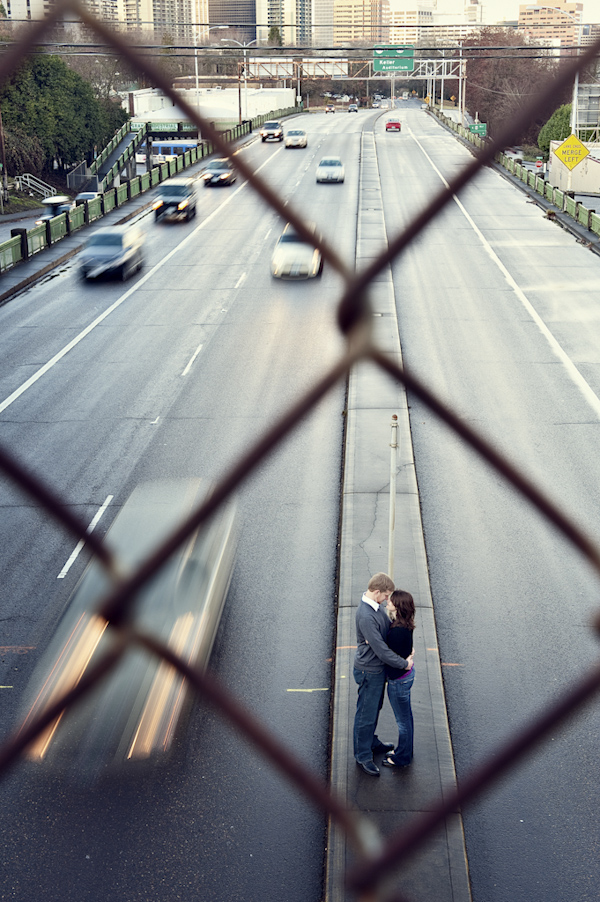 bride and groom hugging in the middle of freeway - wedding photo by top Portland, Oregon wedding photographer Aaron Courter