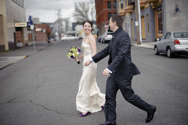 the happy couple walking down the street - wedding photo by top Portland, Oregon wedding photographer Aaron Courter