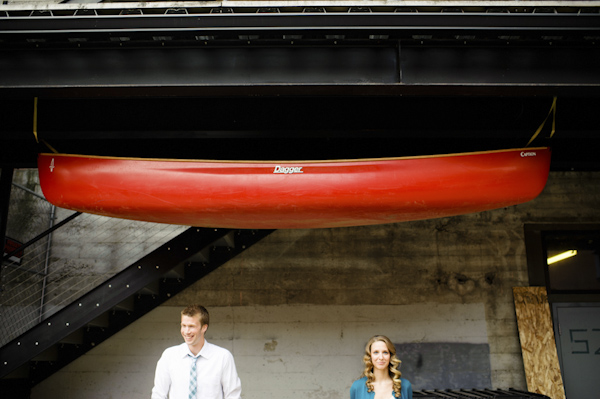 portrait of the happy couple under canoe - wedding photo by top Portland, Oregon wedding photographer Aaron Courter