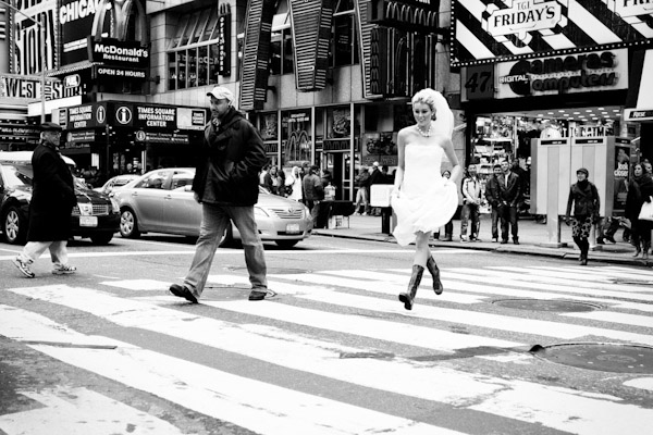 Adorable bride running across the street in Times Square - wedding photo by Adagion Studio
