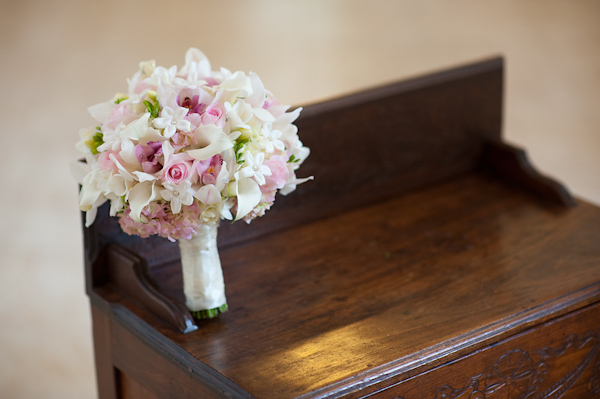 Pink, ivory, white, and green floral bouquet sitting on antique furniture - photo by Houston based wedding photographer Adam Nyholt