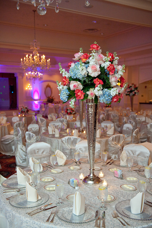 Reception Seating Decoration Dark Pink Light Blue Green And White Fl Arrangement In Tall Silver Vase As Centerpiece