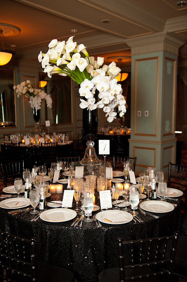 Reception Table Setting Black Tablecloth Chairs And Vase With White Green Fl Arrangement As Centerpiece