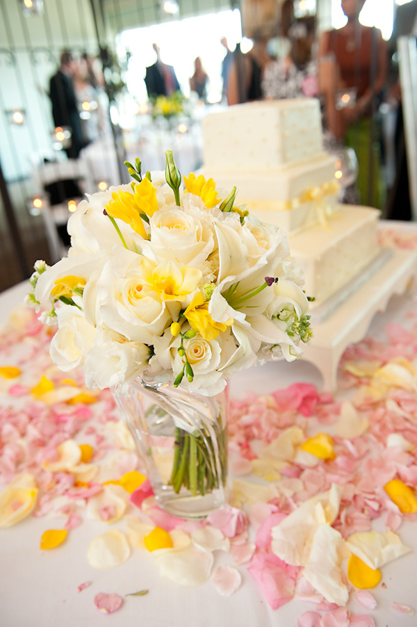 photo of the cake table decorated with a white tablecloth covered ...