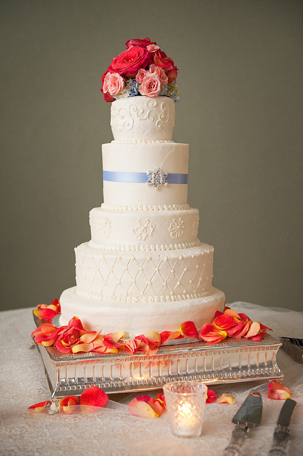 Image Of A Beautiful White Five Tier Round Wedding Cake Decorated With A Light Blue Ribbon