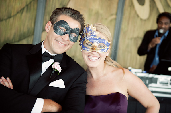 the newlywed donning masks - photo by Houston based wedding photographer Adam Nyholt