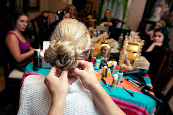 the bride getting ready with her bridesmaids - photo by Houston based wedding photographer Adam Nyholt