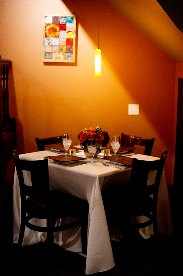 private table in the corner with bouquet of flowers - photo by Denver based wedding photographers Adam and Imthiaz