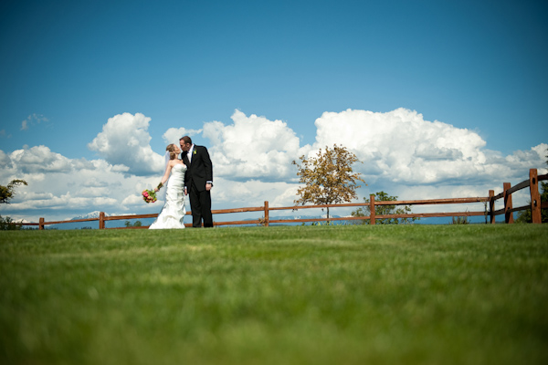 green grass, blue skies and a happy couple, photo by Portland wedding photographer Barbie Hull