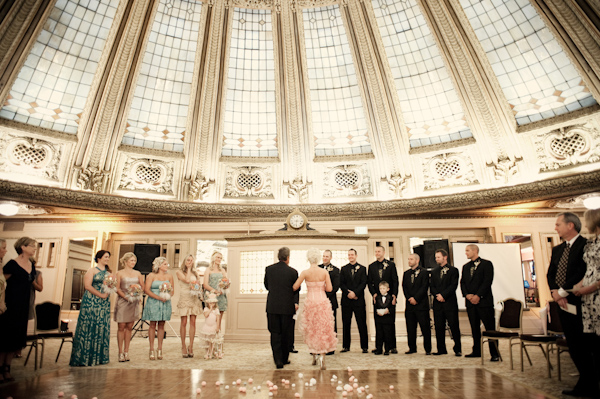 Beautiful interior architecture - Bride walking down the aisle with wedding party standing up front - photo by Portland wedding photographer Barbie Hull