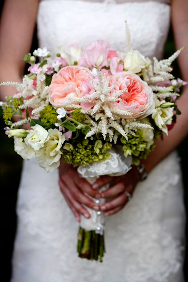 bride holds assorted pink and white bouquet - charming Hudson Valley NY wedding photo by top New York wedding photographers Belathee Photography