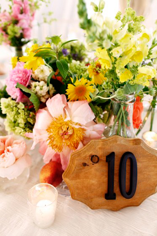 wooden table number with candles and assorted floral centerpieces - charming Hudson Valley NY wedding photo by top New York wedding photographers Belathee Photography