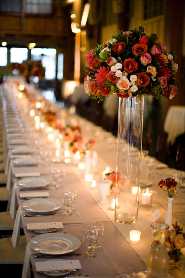 Romantic wedding reception seating arrangement with flowers and candles - Wedding Photo by Bradley Hanson