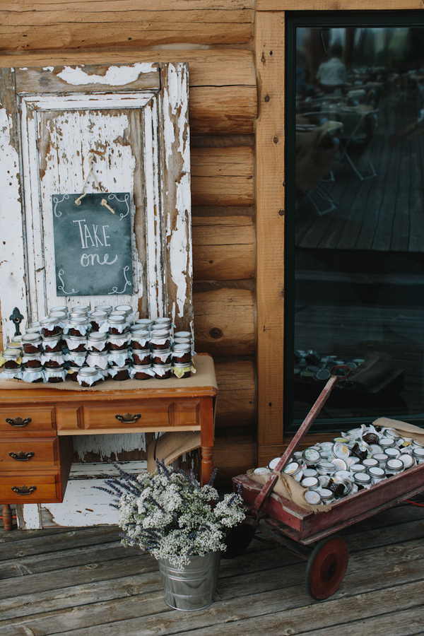 Jam jar wedding favor table with rustic and vintage detail - wedding photo by Michigan-based wedding photographers Bryan and Mae