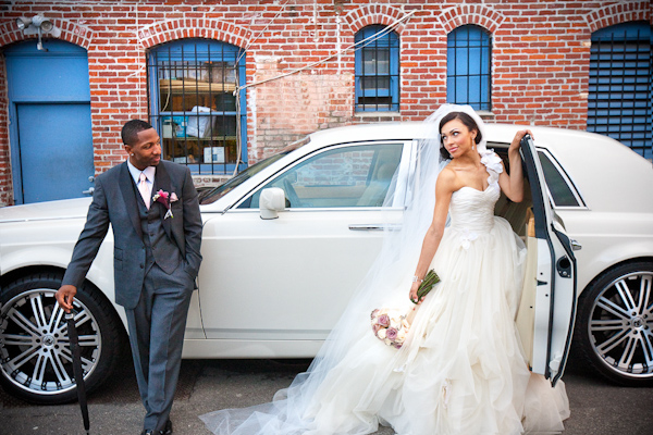 happy couple - towncar - photo by Southern California wedding photographers Callaway Gable