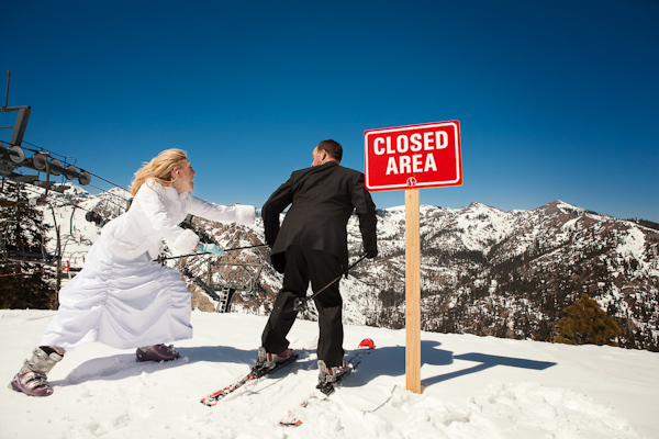 Funny bride and groom in the snow wedding photo by Catherine Hall Studios