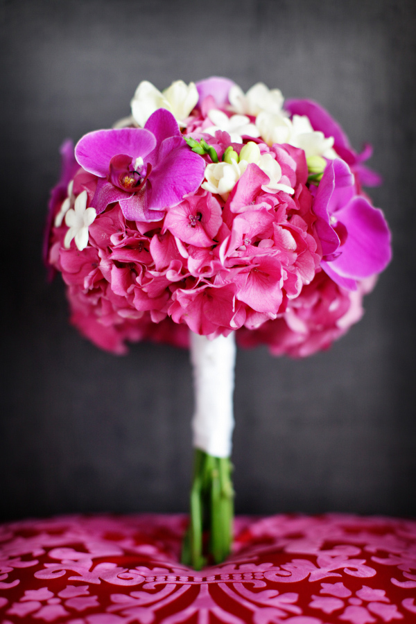 pink and white bouquet with purple orchid accents - photo by destination wedding photographers Chris plus Lynn