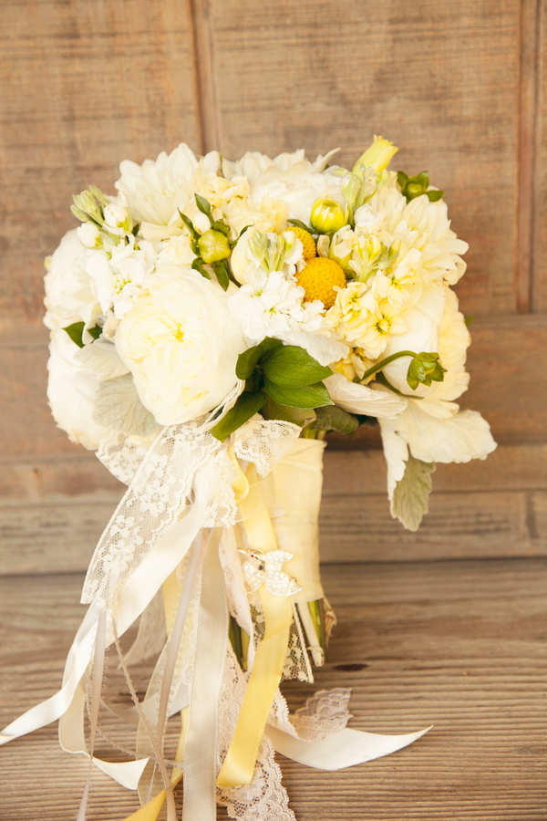 Wedding Photo by Christine Bentley Photography of Yellow and White bouquet with lace and ribbon