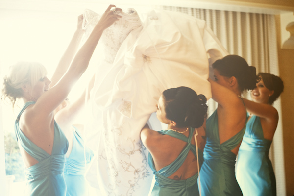 bridesmaids surrounding happy bride - wedding photo by top Orange County, California wedding photographers D. Park Photography