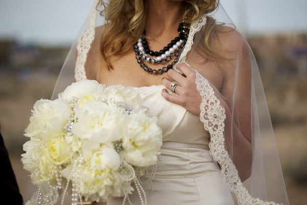 portrait of white bouquet - pearl and beaded necklace - wedding photo by top Orange County, California wedding photographers D. Park Photography