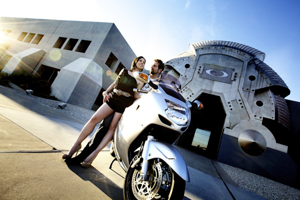 the happy couple standing beside motorcycle - wedding photo by top Orange County, California wedding photographers D. Park Photography