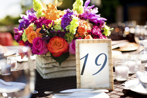 bouquet of flowers as centerpieces next to table numbers - wedding photo by top Orange County, California wedding photographers D. Park Photography