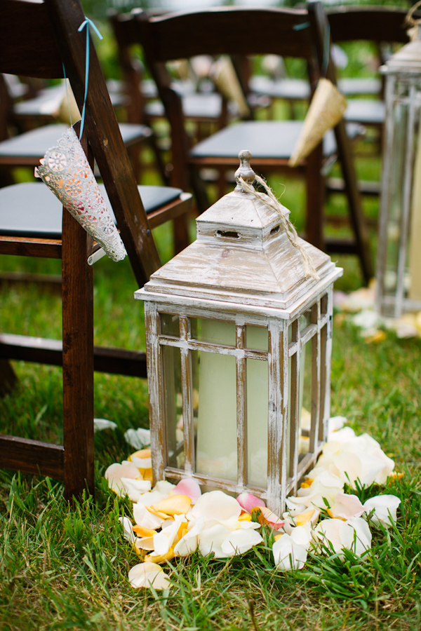 Vintage style lanterns with candles and flower petals as aisle markers - photo by Dan Stewart Photography