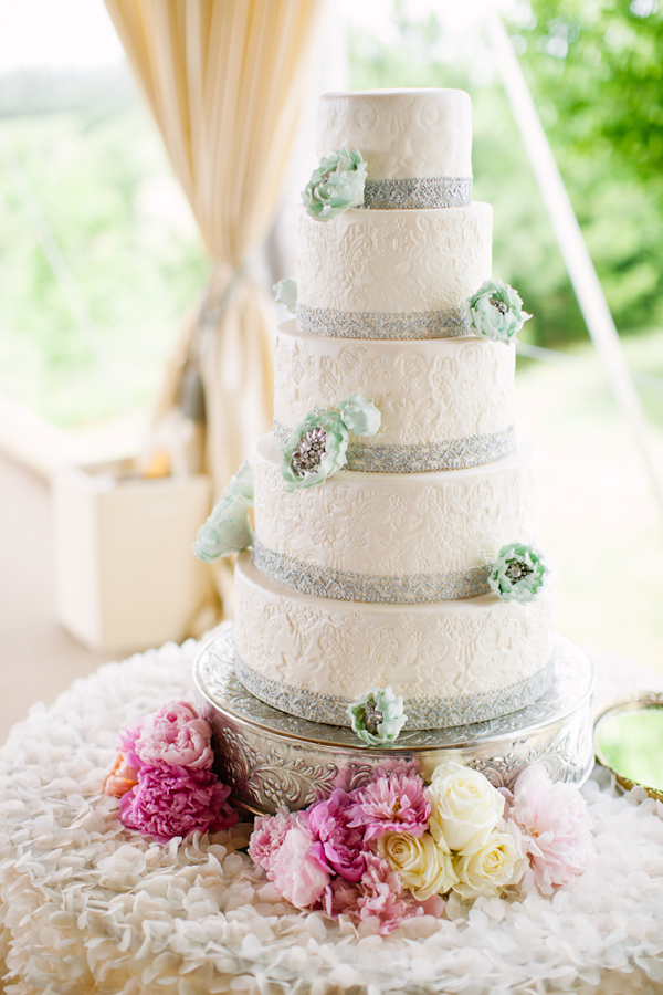 Stunning tiered wedding cake with gray trim and teal flowers - Photo by Dan Stewart Photography