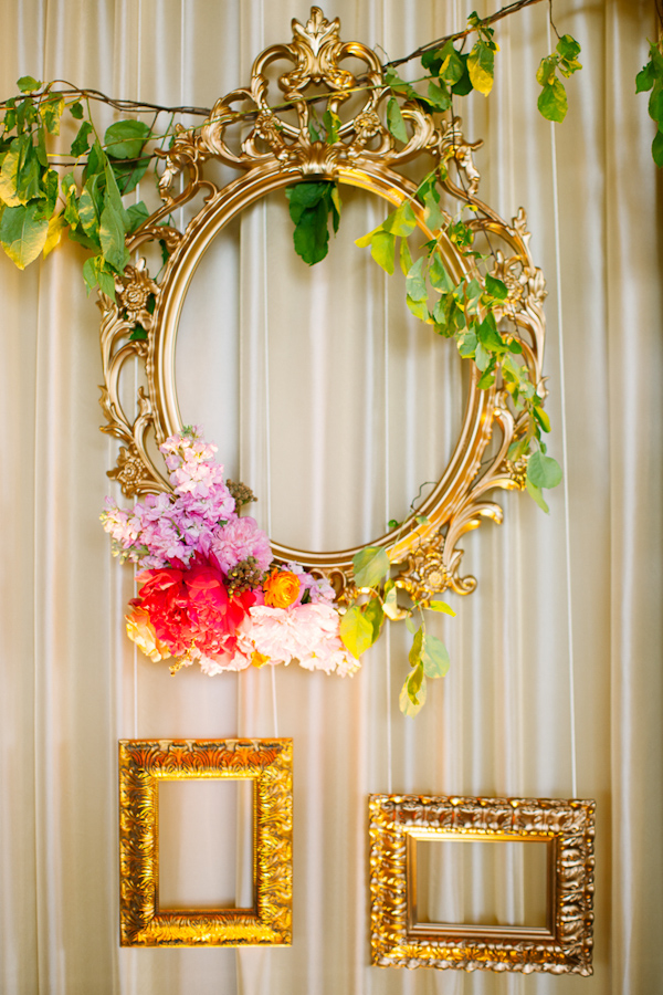 Vintage inspired gold frames hanging as wedding decor - Photo by Dan Stewart Photography