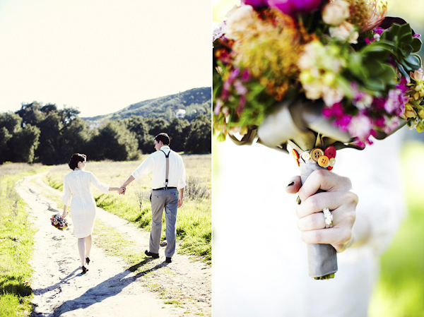 the happy couple walking down road - bouquet of flowers with buttons attached - wedding photo by top Swedish wedding photographers Dayfotografi