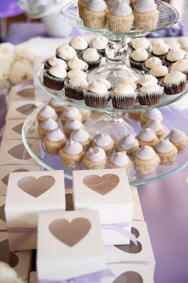 cupcakes on stand with heart favor boxes - Honolulu destination wedding photo by top Hawaiian wedding photographer Derek Wong