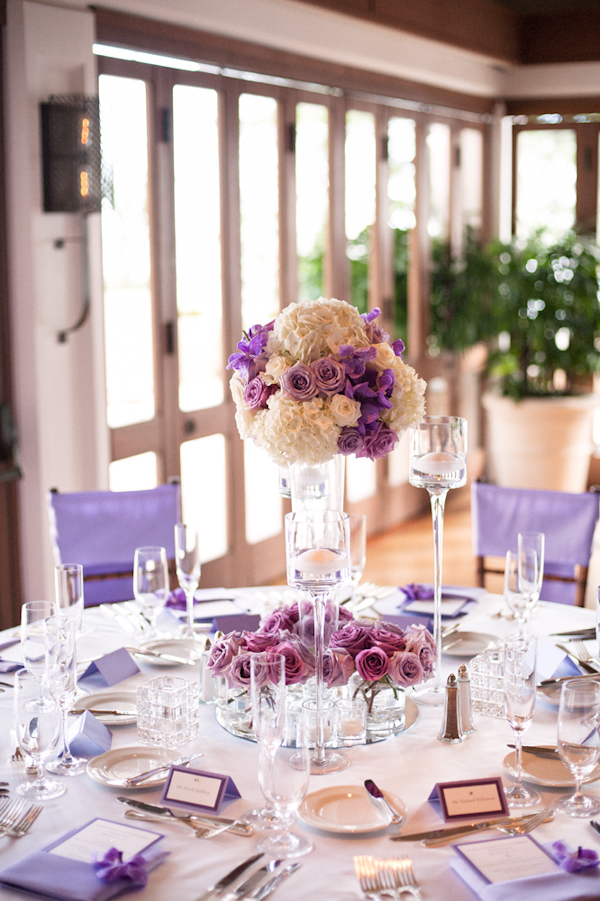 lavender and purple table setting with floral centerpiece - Honolulu destination wedding photo by top Hawaiian wedding photographer Derek Wong