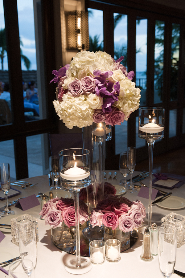 white, lavender and purple centerpiece with candles - Honolulu destination wedding photo by top Hawaiian wedding photographer Derek Wong