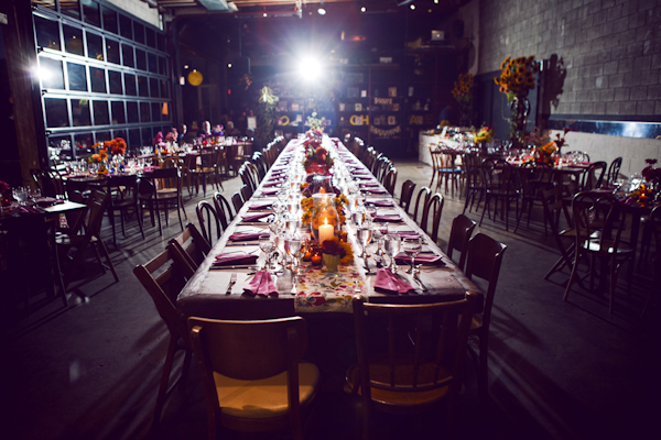 a long table in the center of a colorful warehouse reception site - vintage LA wedding at The Smog Shoppe photo by top Orange County wedding photographer Duke Images