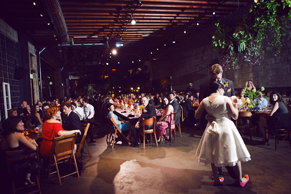 bride and groom share a first dance in a warehouse reception site - vintage LA wedding at The Smog Shoppe photo by top Orange County wedding photographer Duke Images