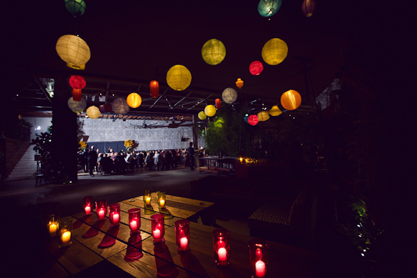 outdoor ceremony/reception site with paper lanterns and colorful candles - vintage LA wedding at The Smog Shoppe photo by top Orange County wedding photographer Duke Images