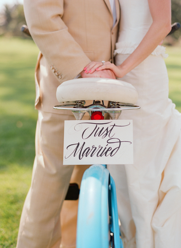 bride and groom with bicycle wedding photo by Elizabeth Messina Photography