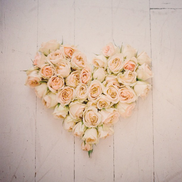 Heart shaped floral arrangement of pink roses, photo Elizabeth Messina Photography