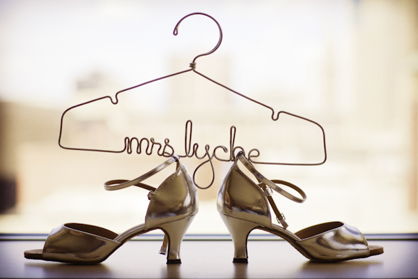 wedding hanger resting on top of bride's shoes - wedding photo by top Denver based wedding photographer Hardy Klahold