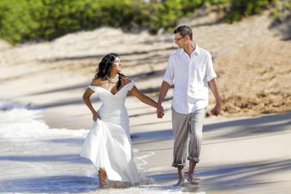 the newlywed walking on the beach - wedding photo by top Denver based wedding photographer Hardy Klahold