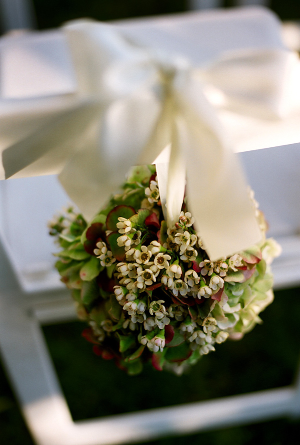 Chair back bouquet - wedding photo by Harrison Hurwitz Photography