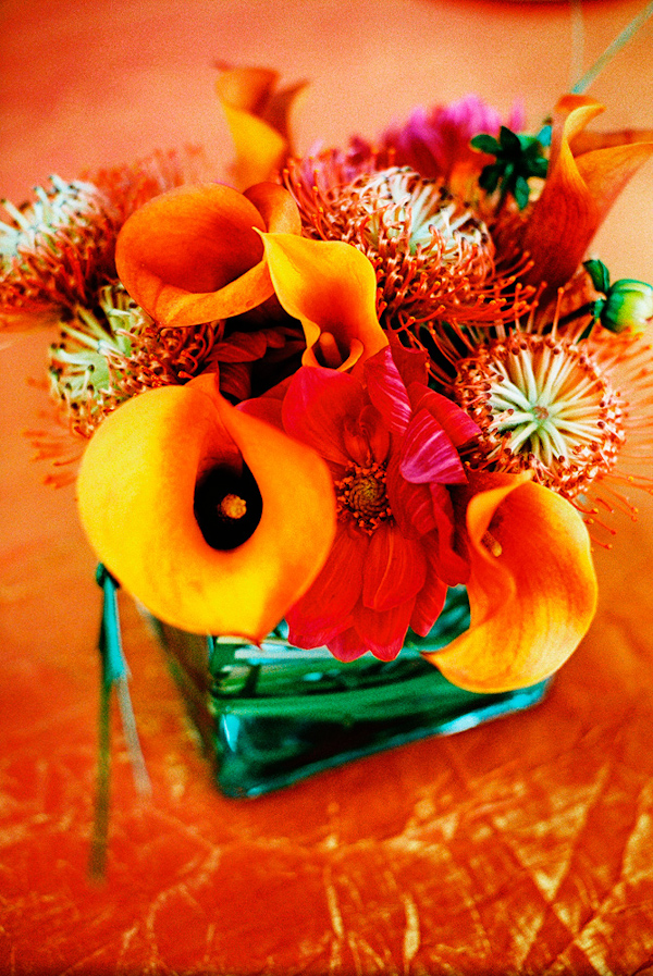 Modern orange callow lilly centerpiece wedding photo by