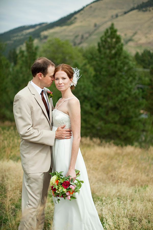 beautiful bride in ivory a-line wedding gown with groom in tan ...