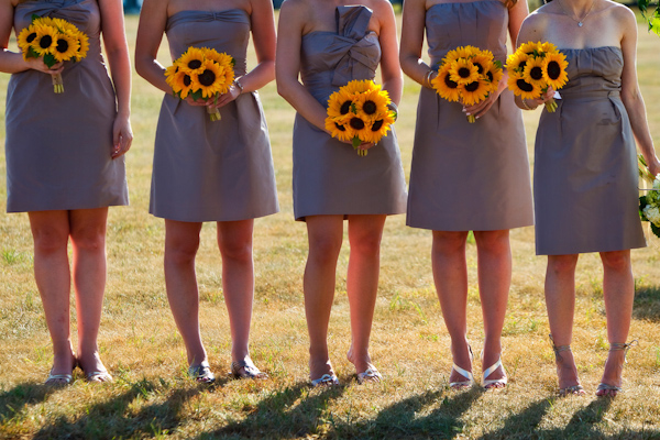 bridesmaids wearing blue-gray dresses holding yellow sunflower bouquets - photo by Washington DC based wedding photographers Holland Photo Arts