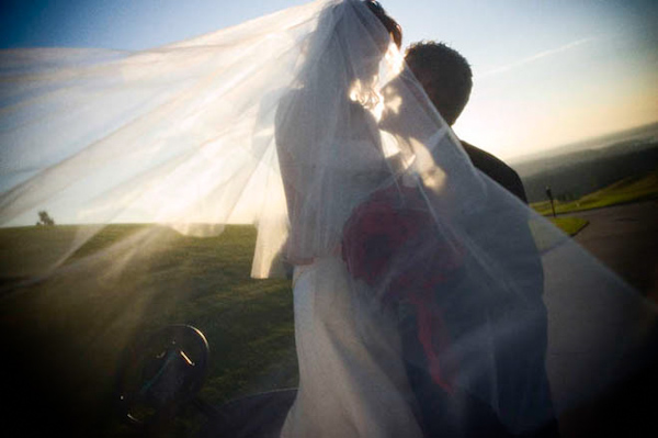 Sunlit, bride and groom, full length veil -  wedding photo by J Garner Photographer,