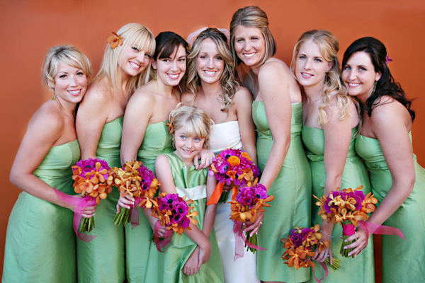 Bride Bridesmaids And Flower Girl Posing For Group Portrait