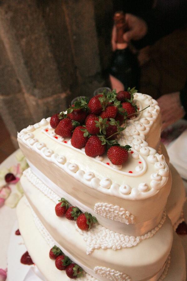 ivory three tier heart shaped wedding cake with strawberry decor