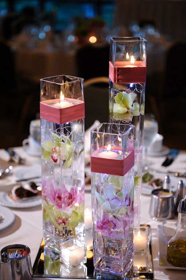 Orchid and candle centerpieces - wedding photo by Kenny Nakai Photography