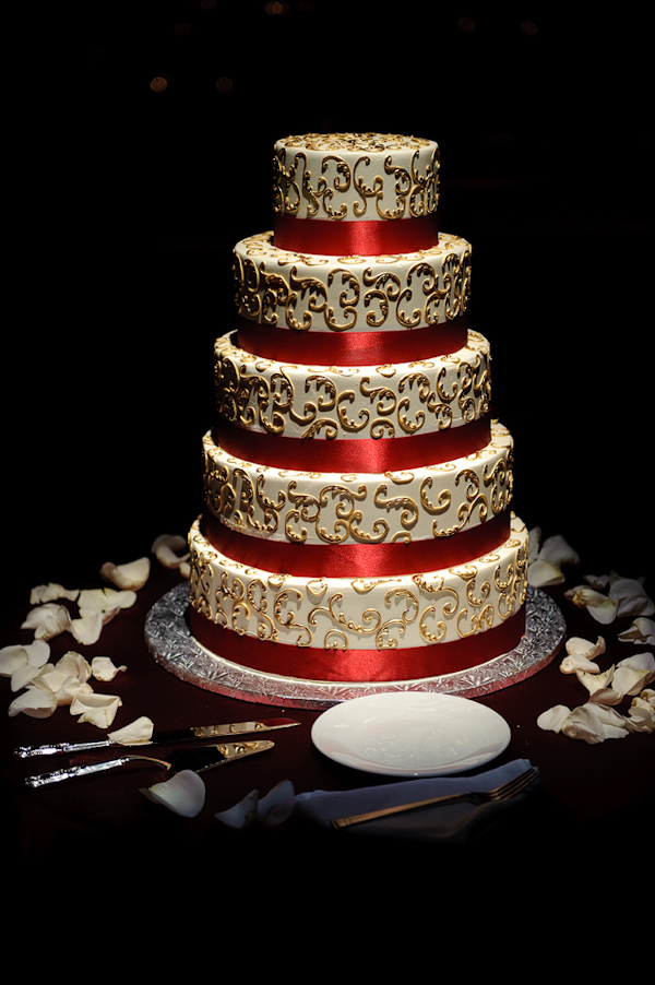 Five layer white, gold, and red wedding cake - photo by Kenny Nakai ...