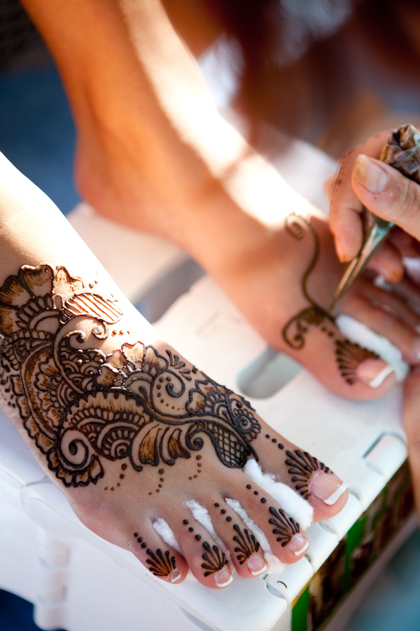 photo of bride getting henna tattoos on her feet - photo by